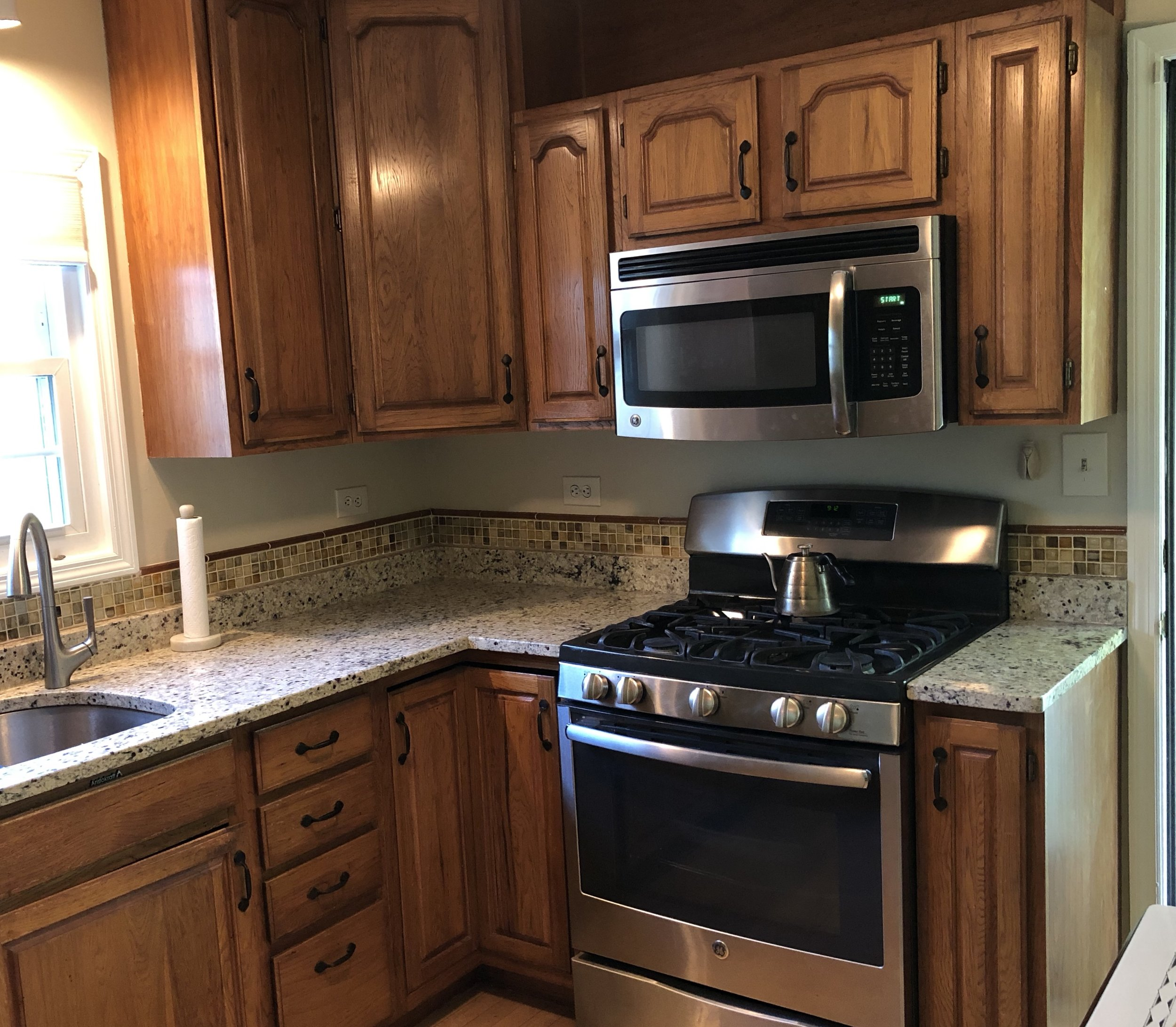 This Delmar homeowner was elated with her painted cabinets.