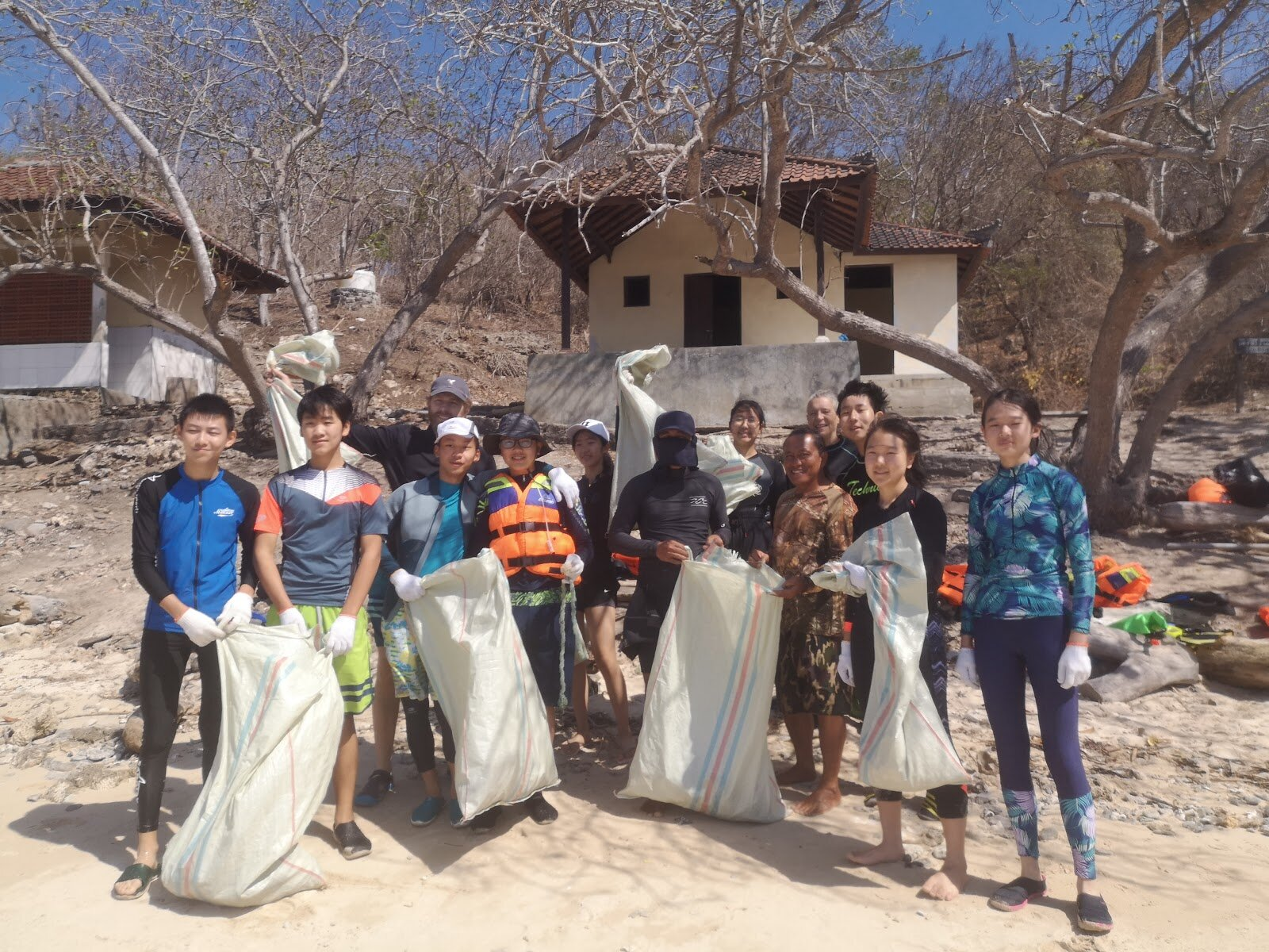 Keystone youths lending their hands and efforts in a beach clean-up, alongside the trash management advocates from Biosphere Foundation