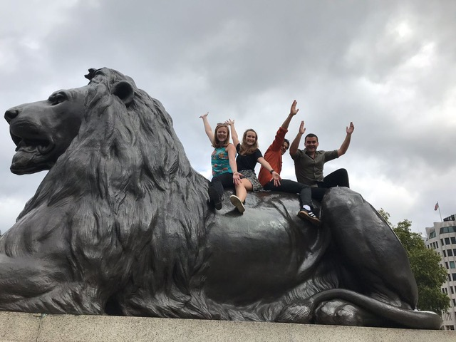 Team having fun in trafalgar square