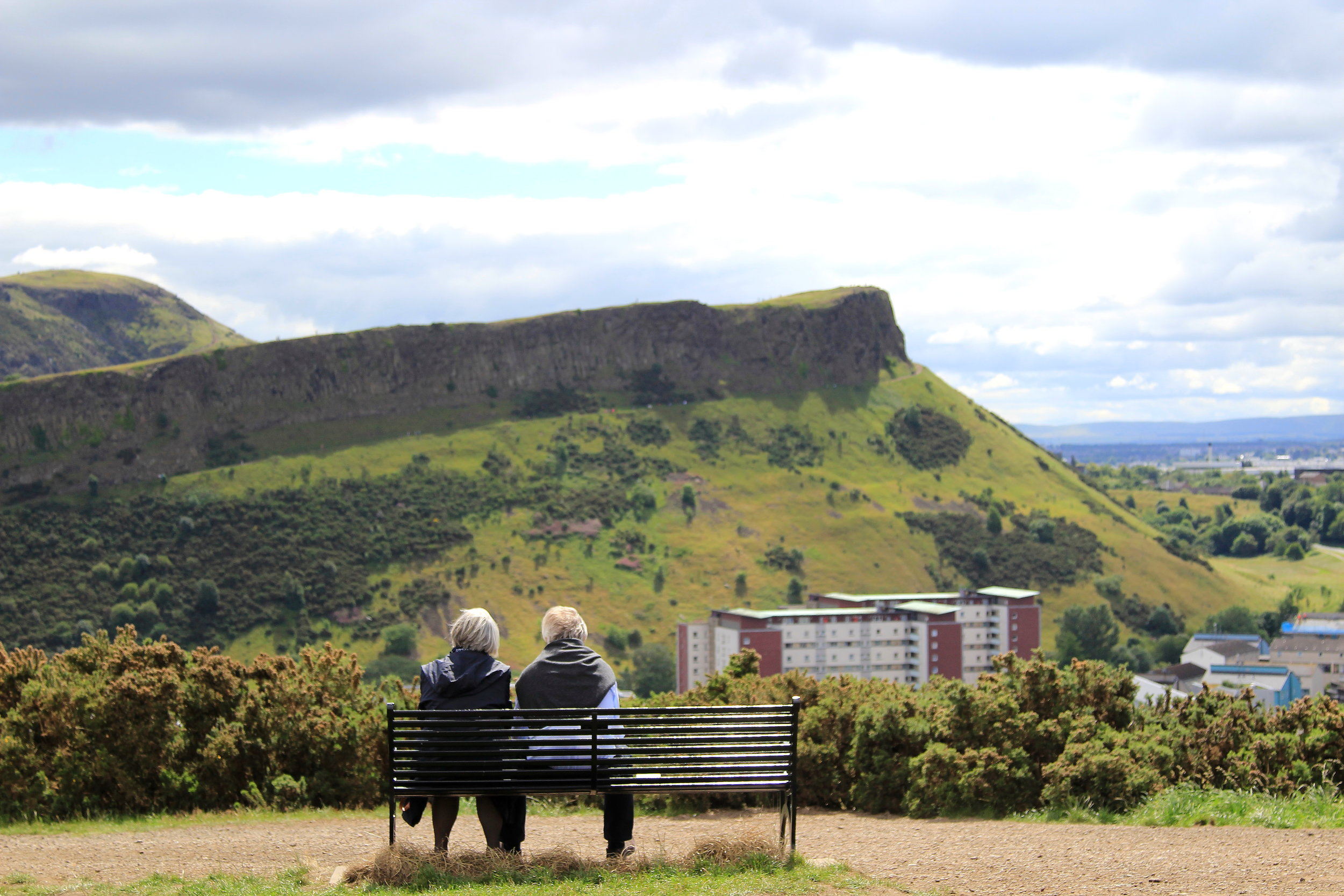 A couple taking in the view of Arthur's Seat, Edinburgh