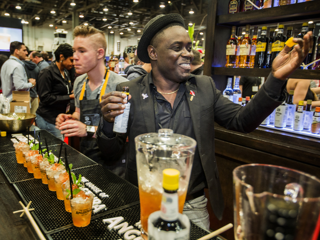Mixologist Raymond Edwards serves a Queen Park Swizzle in the Angostura booth.