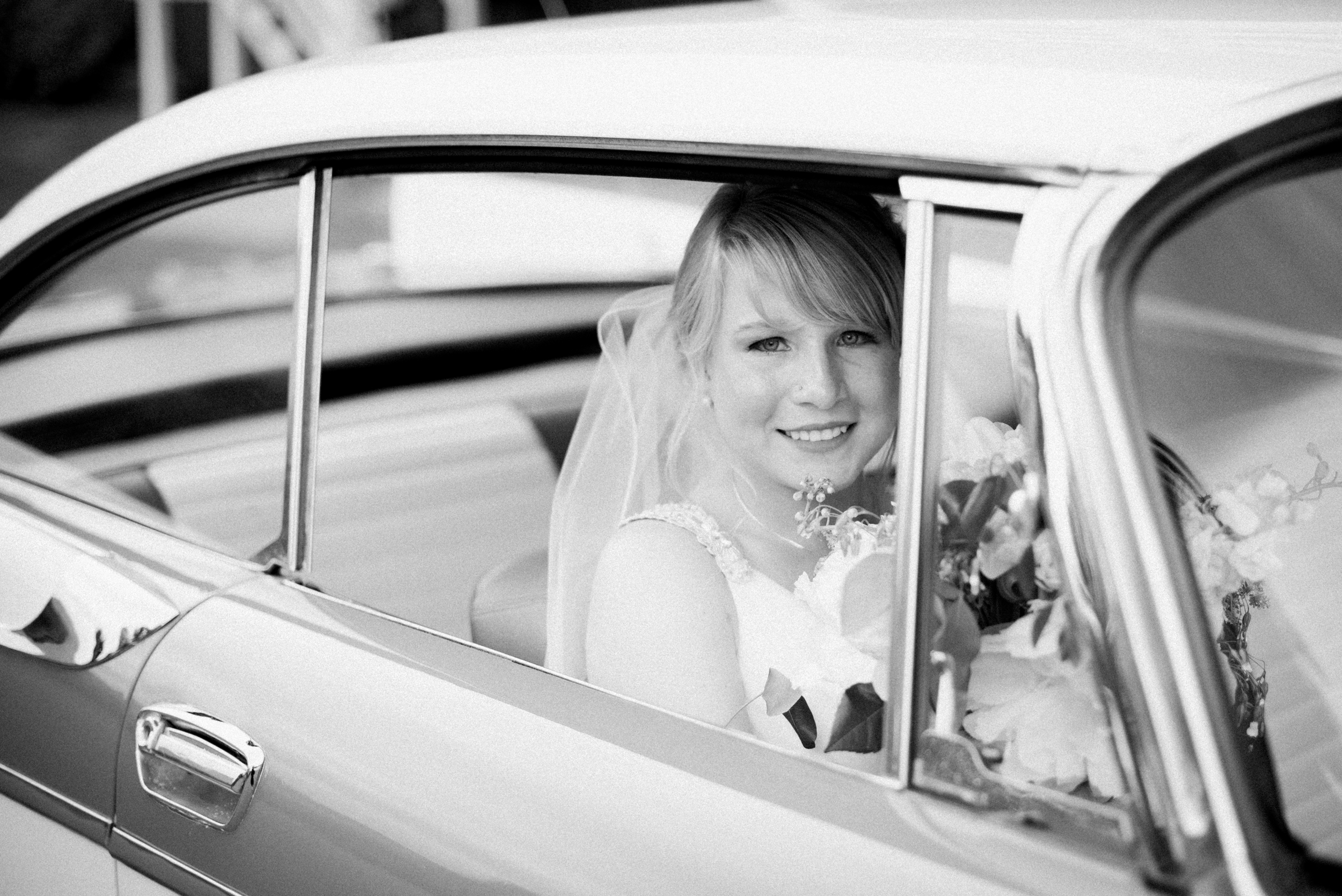 Vintage car bridal portrait