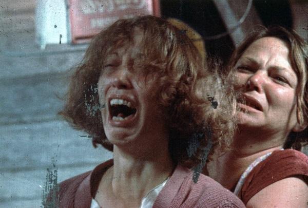 Mattie (Louise Fletcher)restraining a hysterical Keechie.
