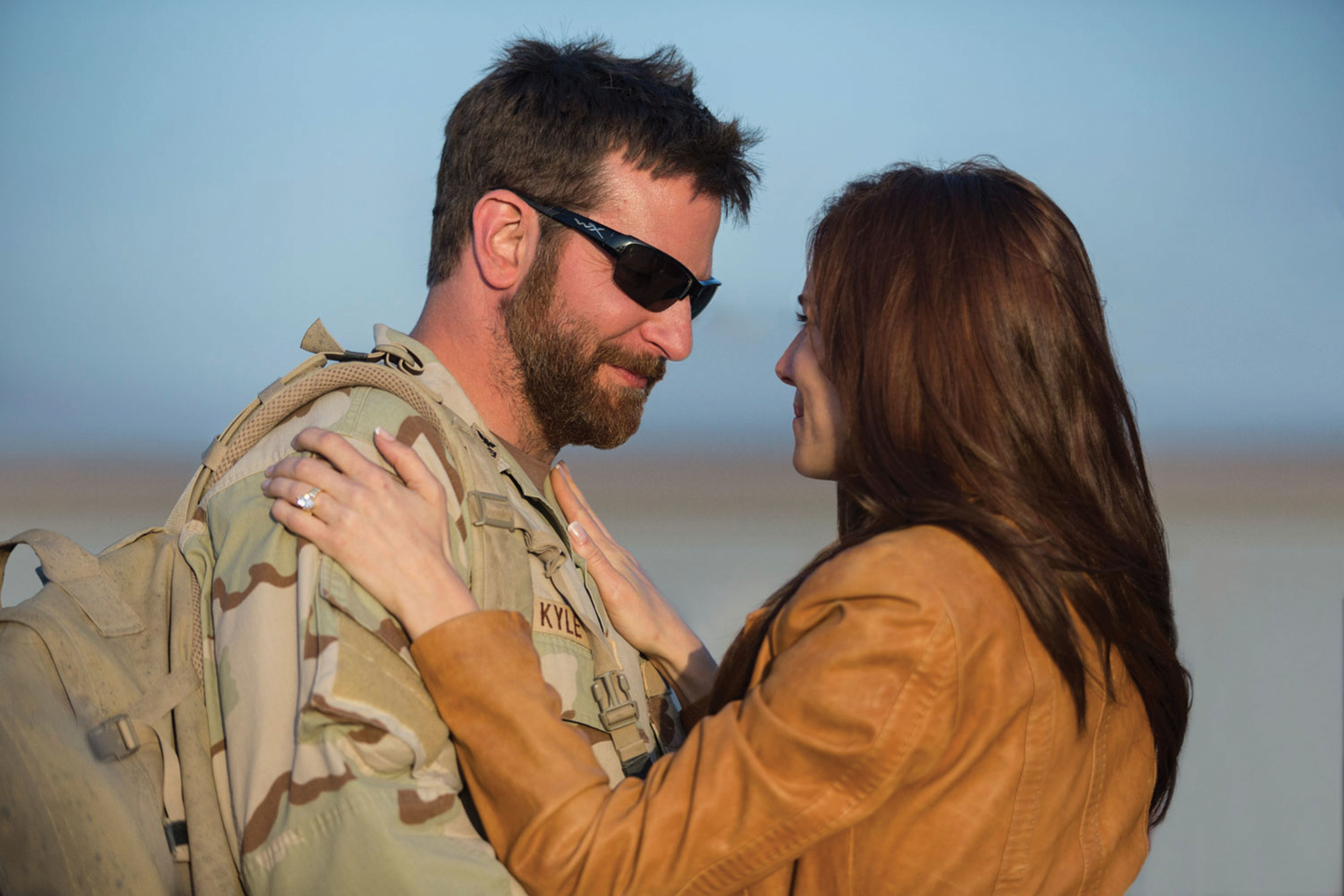 Chris Kyle (Bradley Cooper) and wife Taya (Sienna Miller), his steadfast if not always happy home front support system.
