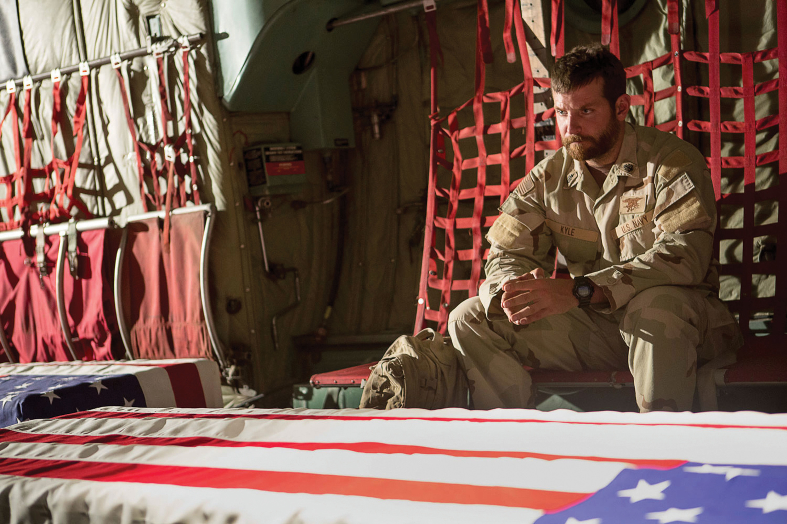 Chris Kyle (Bradley Cooper) returning home with two of the 4,491 Americans killed during the Iraq war.