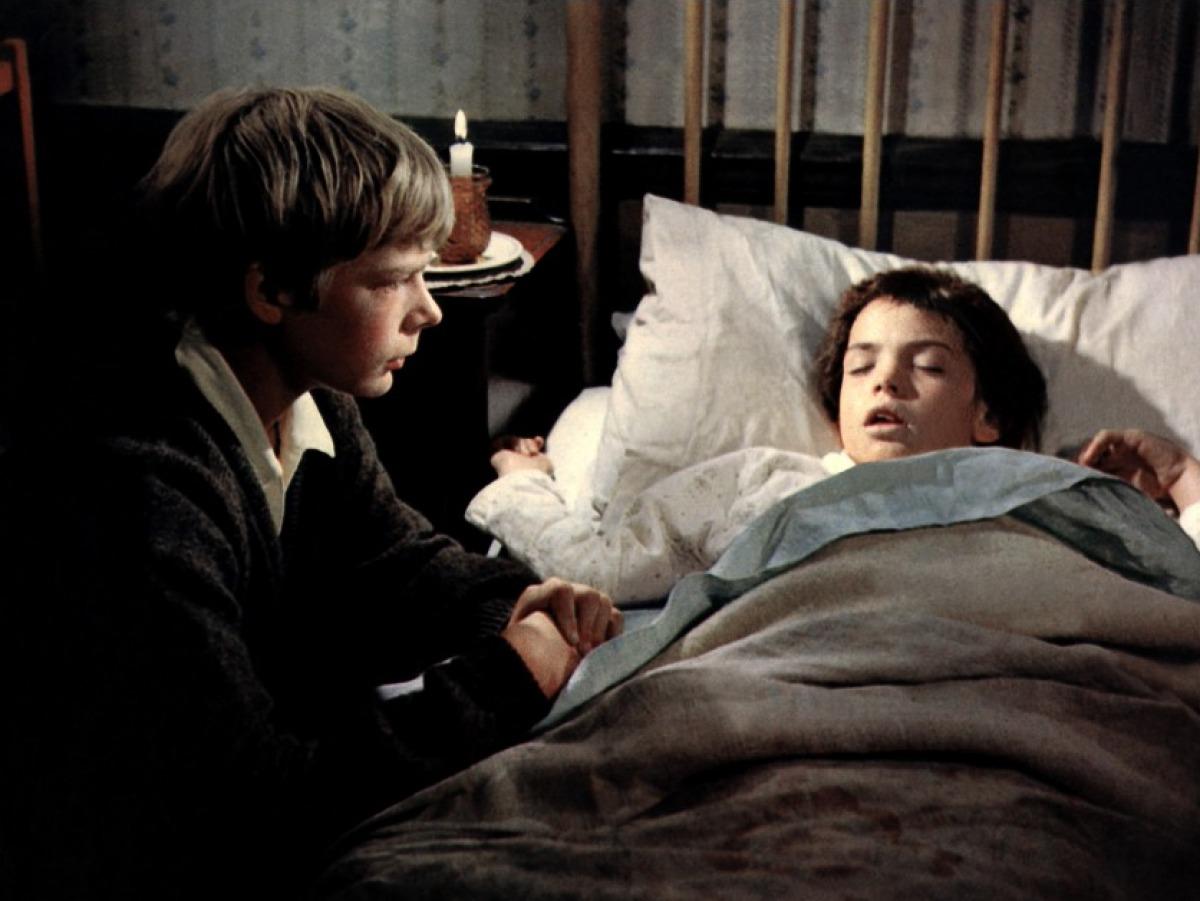 Hubert (Louis Sheldon Williams) comforts his ailing sister Gerty (Sarah Nicholls).