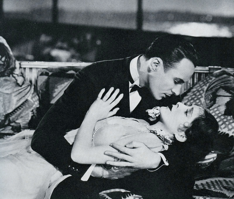 Michael Towne (Rod la Roque) and Joan Winslow (Billie Dove) in  The Man and the Moment