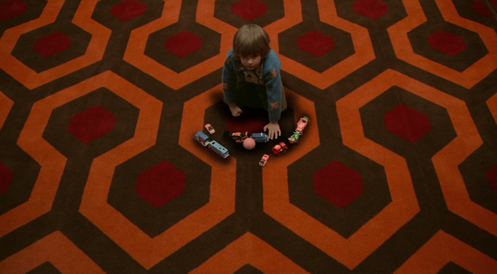 Danny is enmeshed into the pattern of the rug at The Overlook