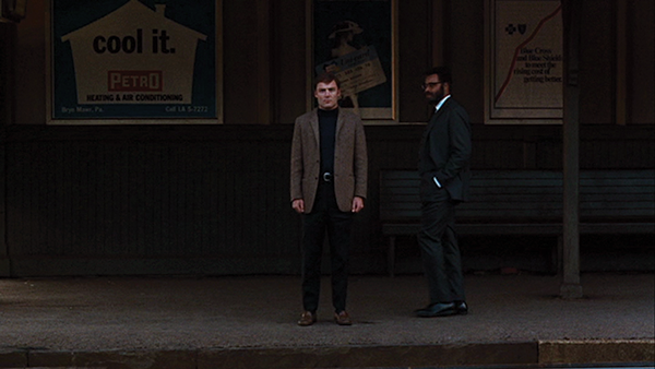 Stacy Keach as the catatonic Jacob Horner meeting James Earl Jones as Dr. D at the train station