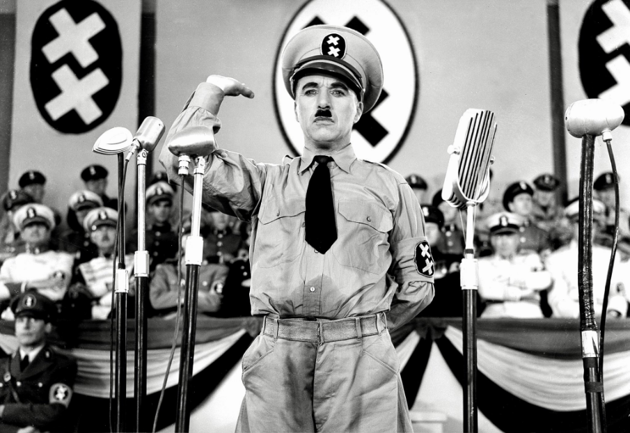 Chaplin as the dictator Hynkel, doing his dance to world domination