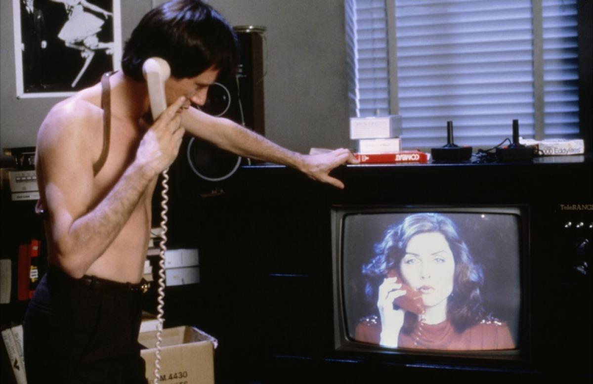 Deborah Harry as radio host Nicki Brand speaks to Max (James Woods)