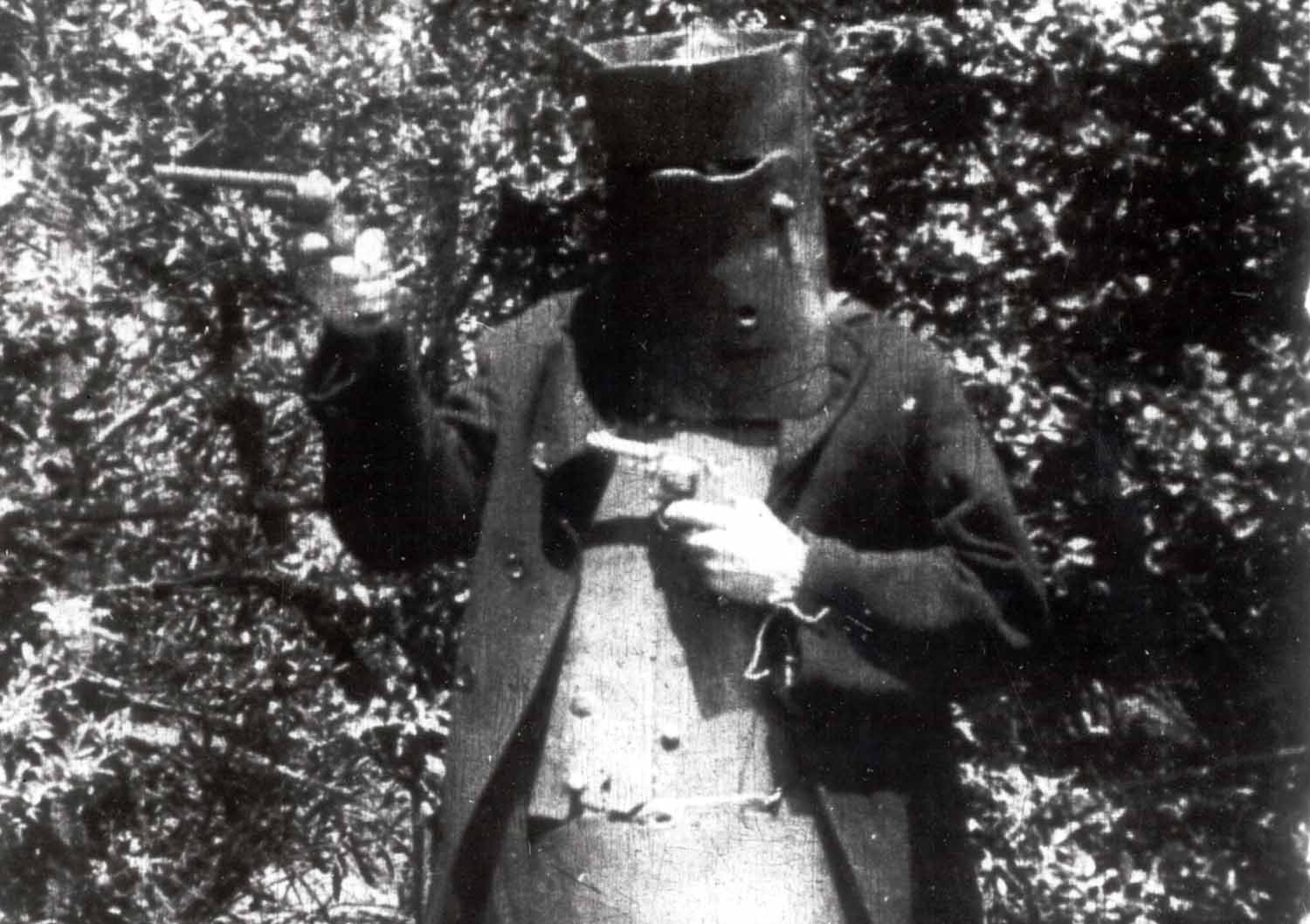 A masked train robber from  The Story of the Kelly Gang  (1906), Australia's first known feature-length film