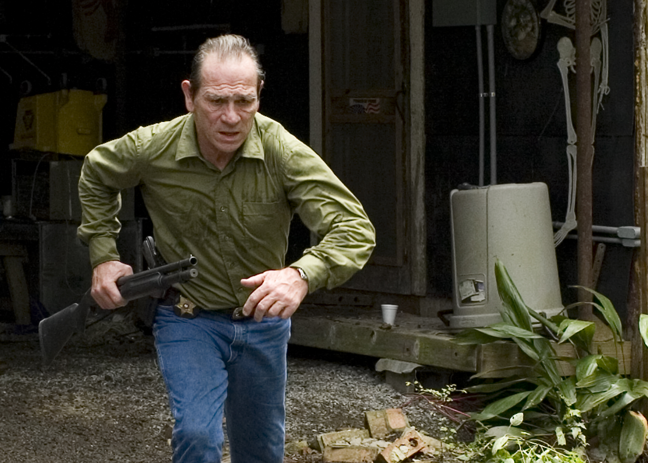 Tommy Lee Jones stars as Dave Robicheaux, a sheriff investigating a young girl's murder