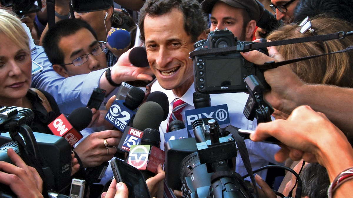 New York City Mayoral candidate Anthony Weiner in the midst of a media scrum during the height of his sexting scandal.