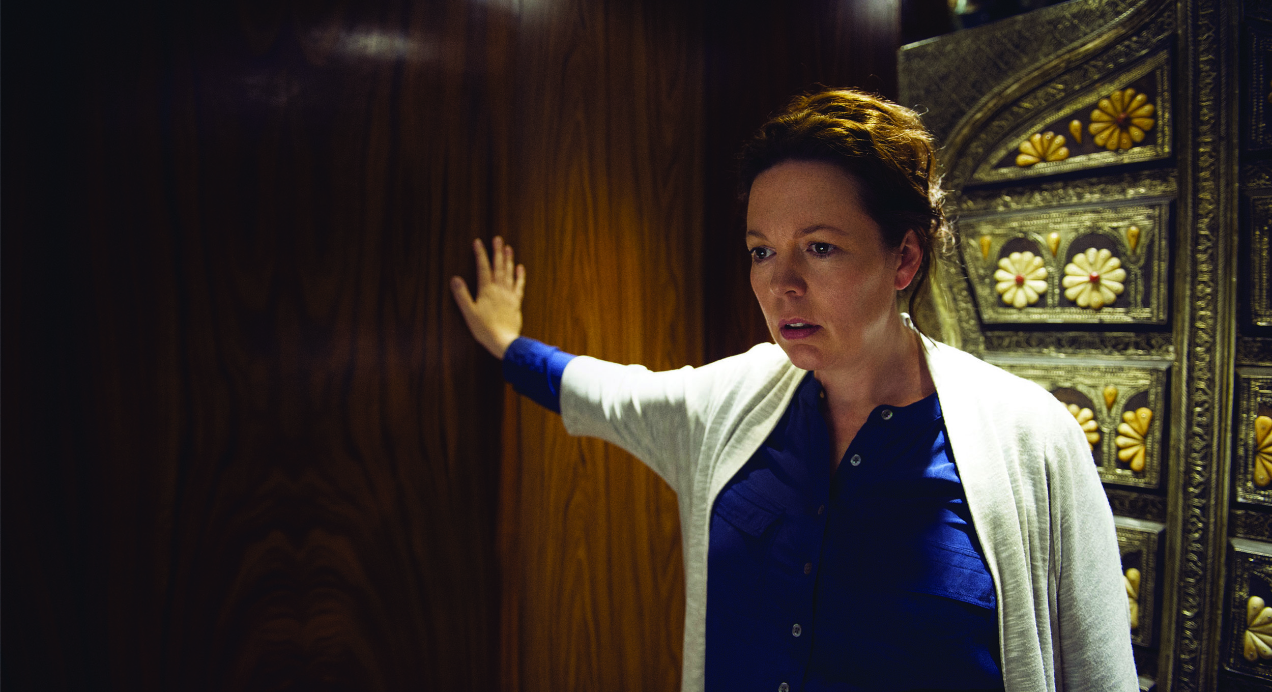 Olivia Colman as British Special Intelligence Service agent Angela Burr.