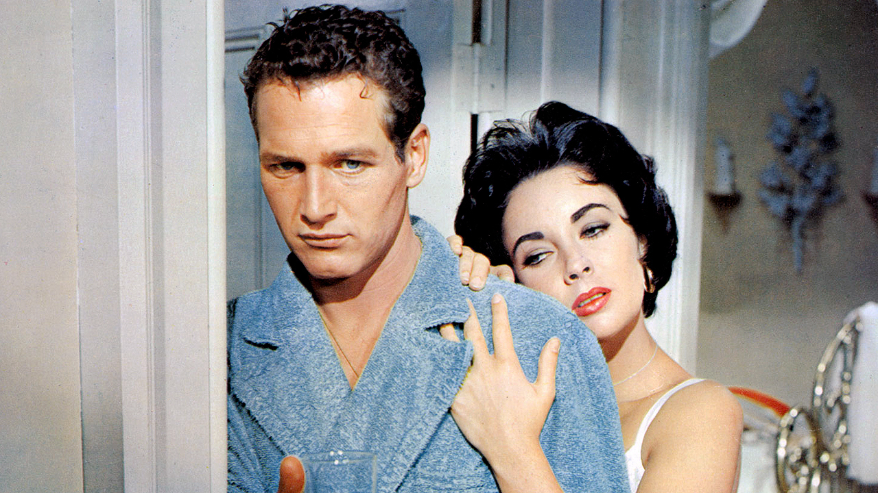 A frustrated Maggie (Elizabeth Taylor) and a sullen, alienated Brick (Paul Newman).