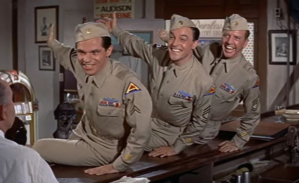 Left to right: Michael Kidd, Gene Kelly, and Dan Dailey  .