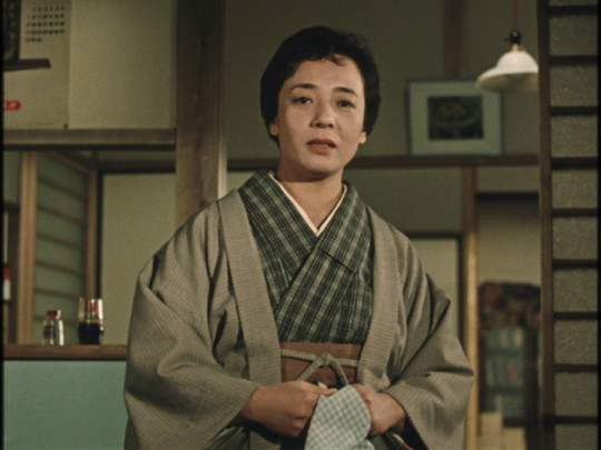 Mrs. Hayashi (Kuniko Miyake) is one of the housewives who regularly engage in gossip with her neighbors.