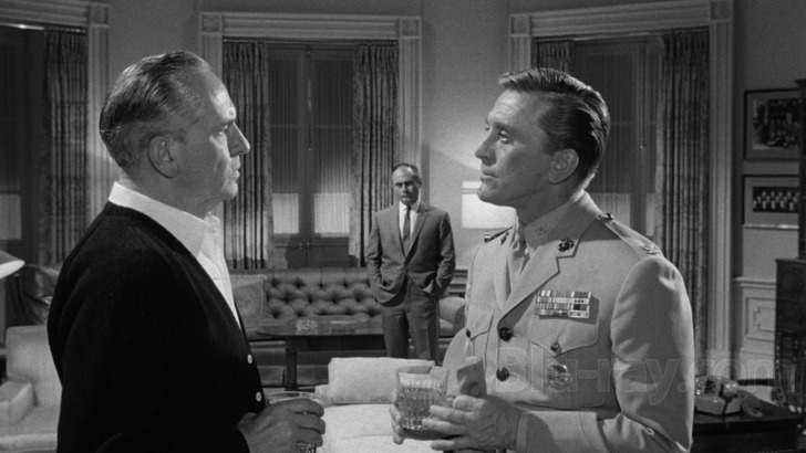 Col. Casey (Kirk Douglas) informs the President of General Scott's plans for a military coup.