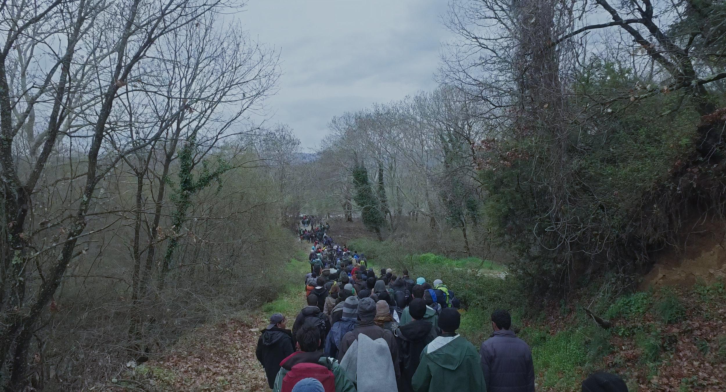 Refugees walking near Idomeni Camp, Greece in  Human Flow .
