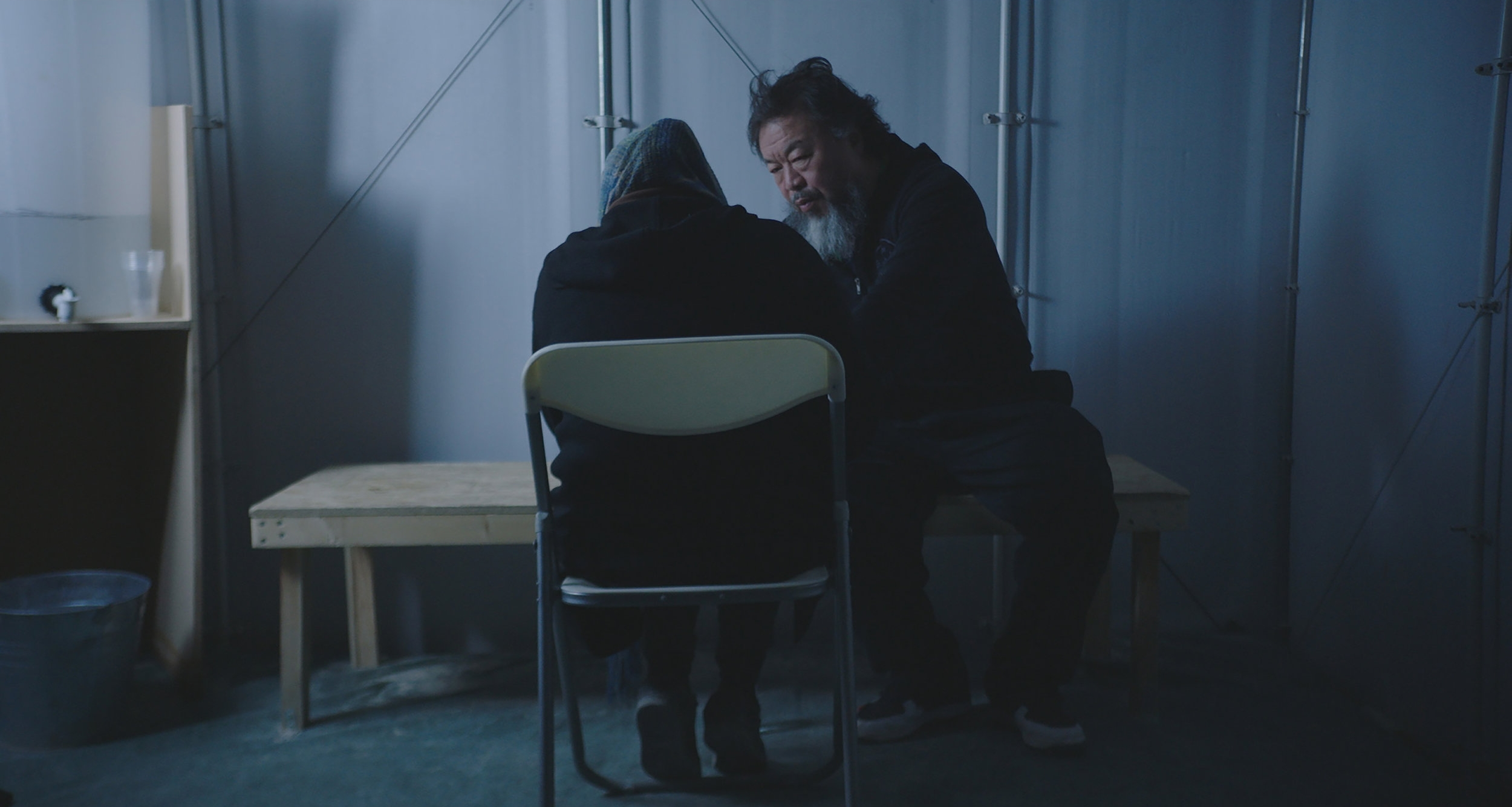 Ai Weiwei with a refugee at the Jordan–Syria border in  Human Flow.