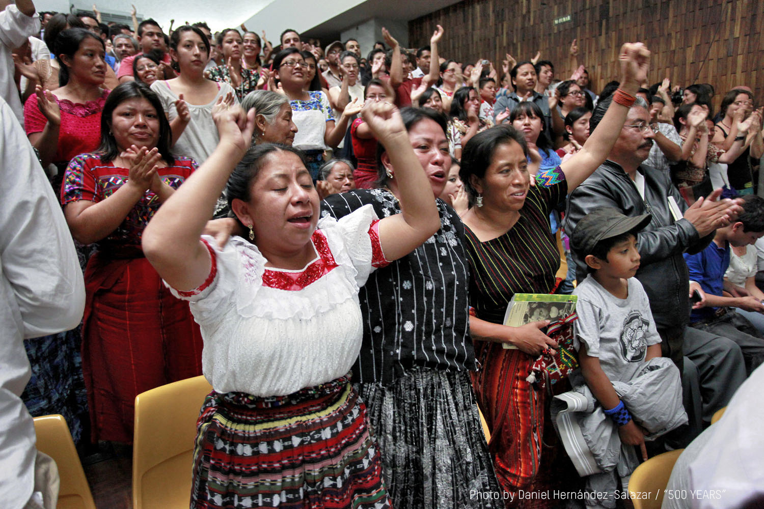 In  500 Years , Mayan survivors of the Guatemalan genocide cheer the guilty verdict against dictator Ríos Montt. He was convicted and sentenced for genocide and crimes against humanity on May 10, 2013, given an 80-year sentence and sent directly to prison. It was the first time the perpetrator of genocide against indigenous people had been tried in a court of law. Photo by Daniel Hernández Salazar.