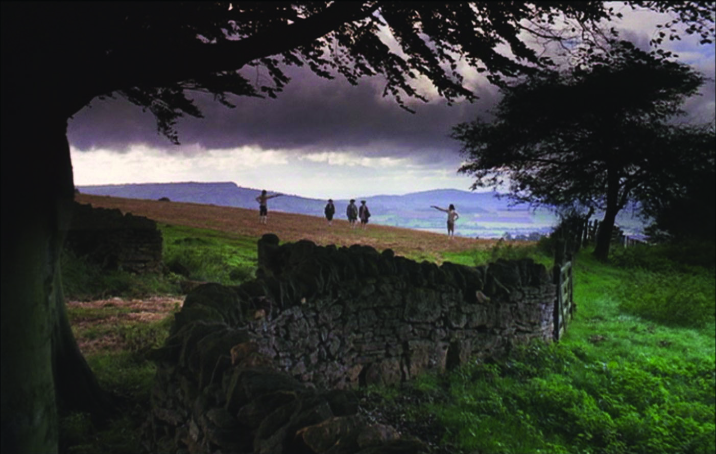 The father of Redmond Barry engages in a duel at the start of the film, framed by   mountains and a crumbling stone wall.