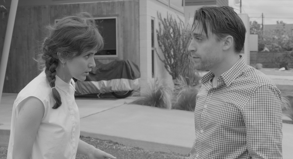 Emotionally infantile himself, Ben (Kieran Culkin, with Trieste Kelly Dunn) schemes to provide ageless babies for needy parents in  Infinity Baby (2017).