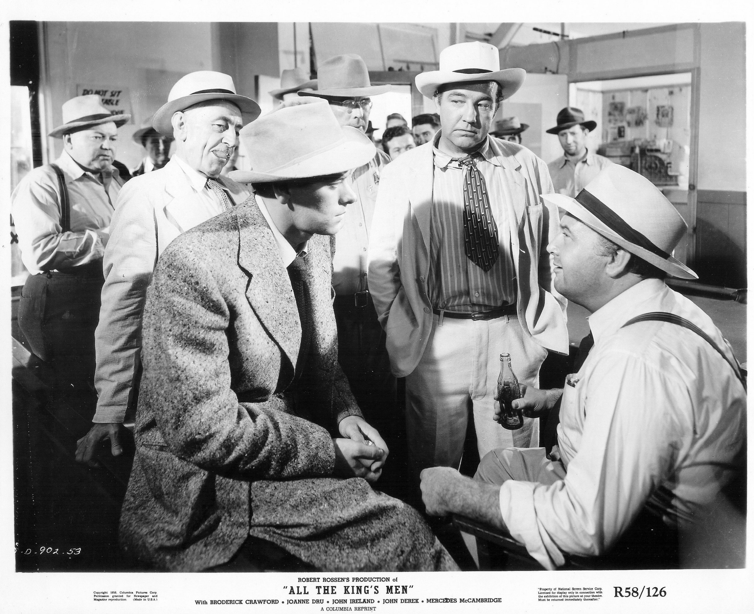 1. Jack Burden (John Ireland, foreground, left), meets Willie Stark (Broderick Crawford, center) and Kanoma City machine members, notably boss Tiny Duffy (Ralph Dumke, right).