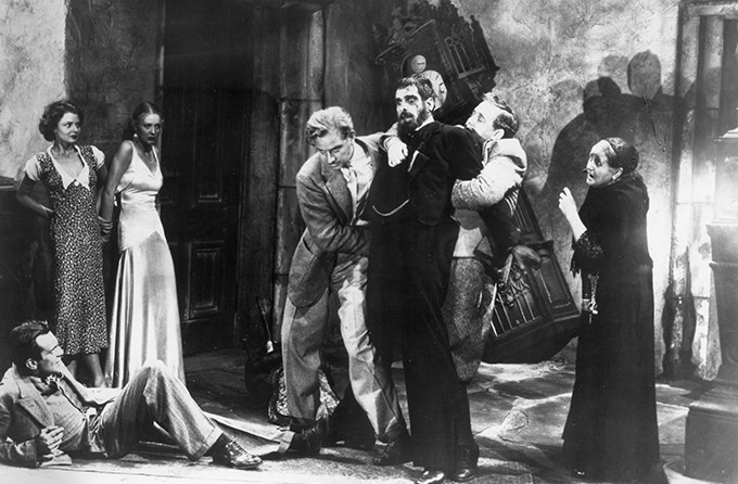 Morgan is restrained by Roger and Sir William Porterhouse (Charles Laughton) as much of the rest of the cast looks on.