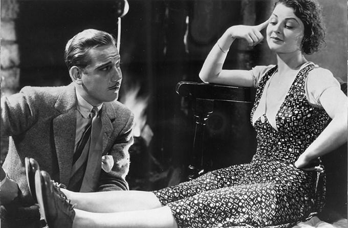 Gladys (Lilian Bond) flirts with Roger.