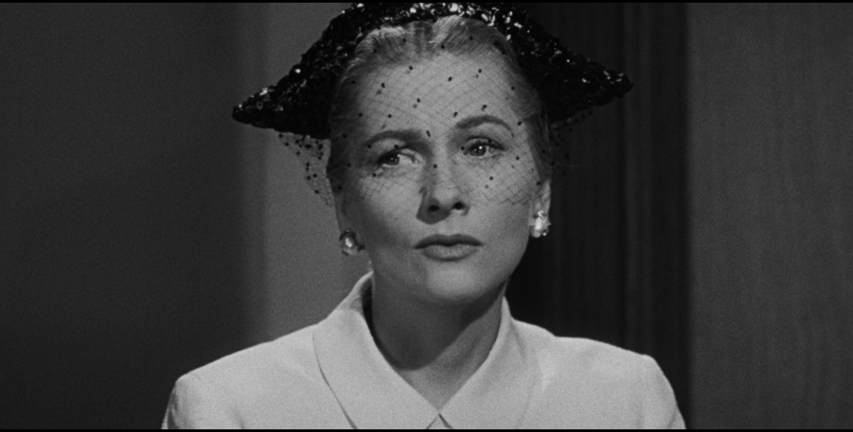Beyond a Reasonable Doubt: A classy pawn in her ex-fiancé's game, Susan Spencer (Joan Fontaine) doesn't know what to believe.