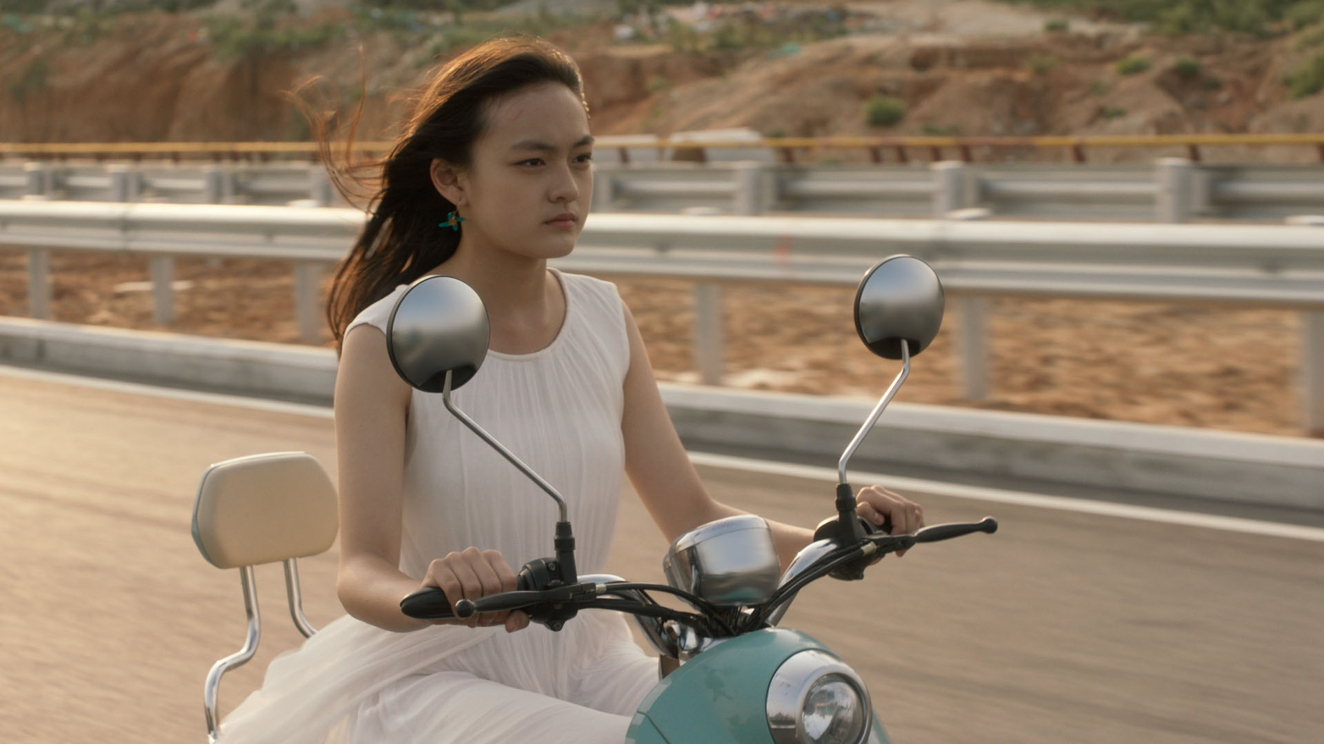 Mia (Qi Wen) rides a stolen motorbike toward an unknown future.