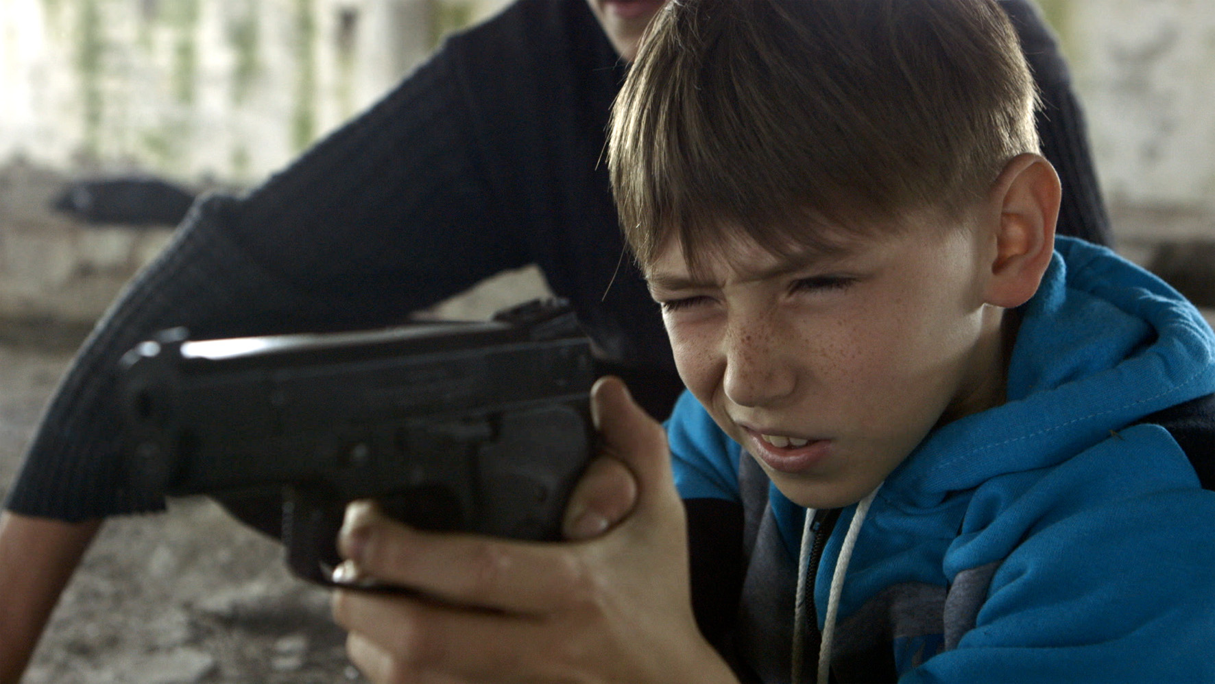 10-year-old Oleg's innocence is eroded by his family's position on the frontline of hostilities between Russia and Ukraine in Simon Lereng Wilmont's  The Distant Barking of Dogs.