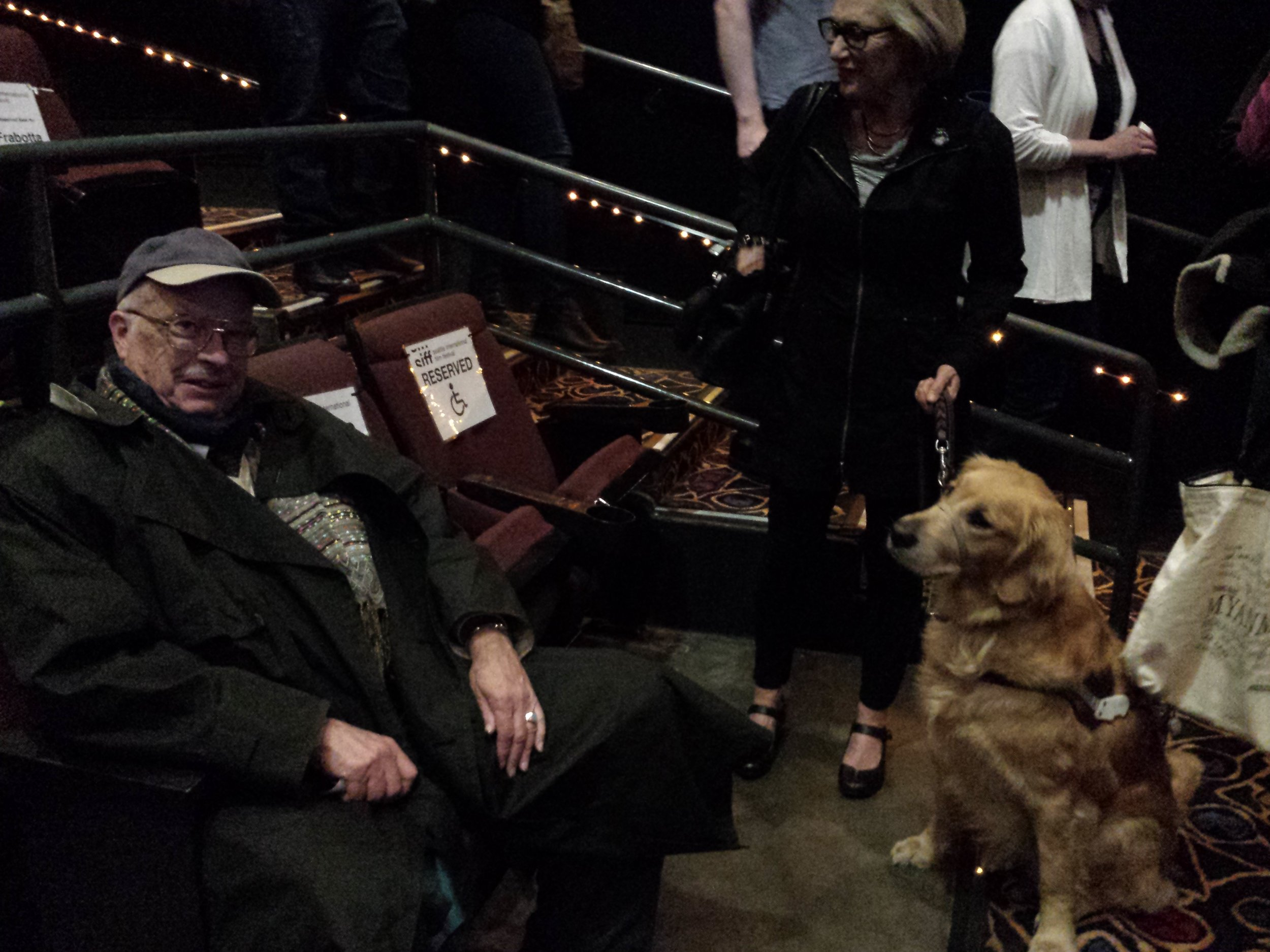 A service dog, a trainer, and a critic meet at a screening of  Pick of the Litter.