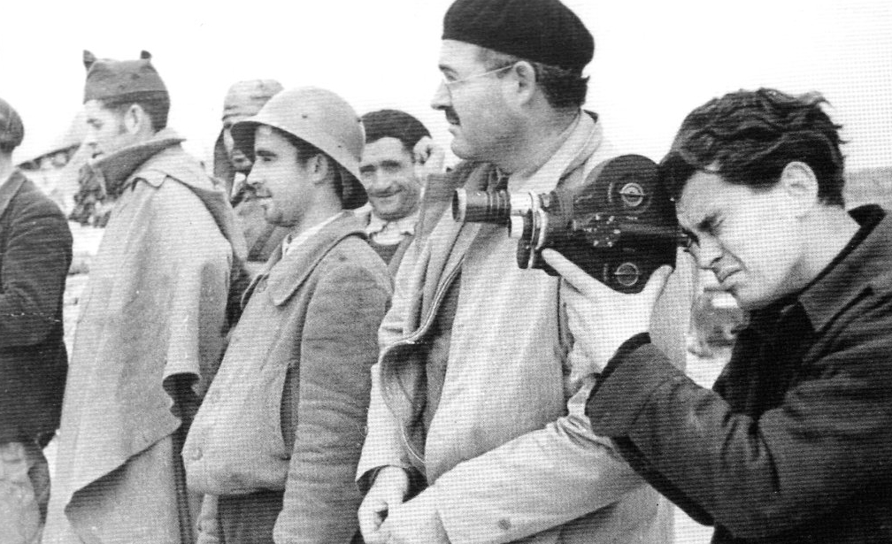 Ivens with camera and Hemingway.