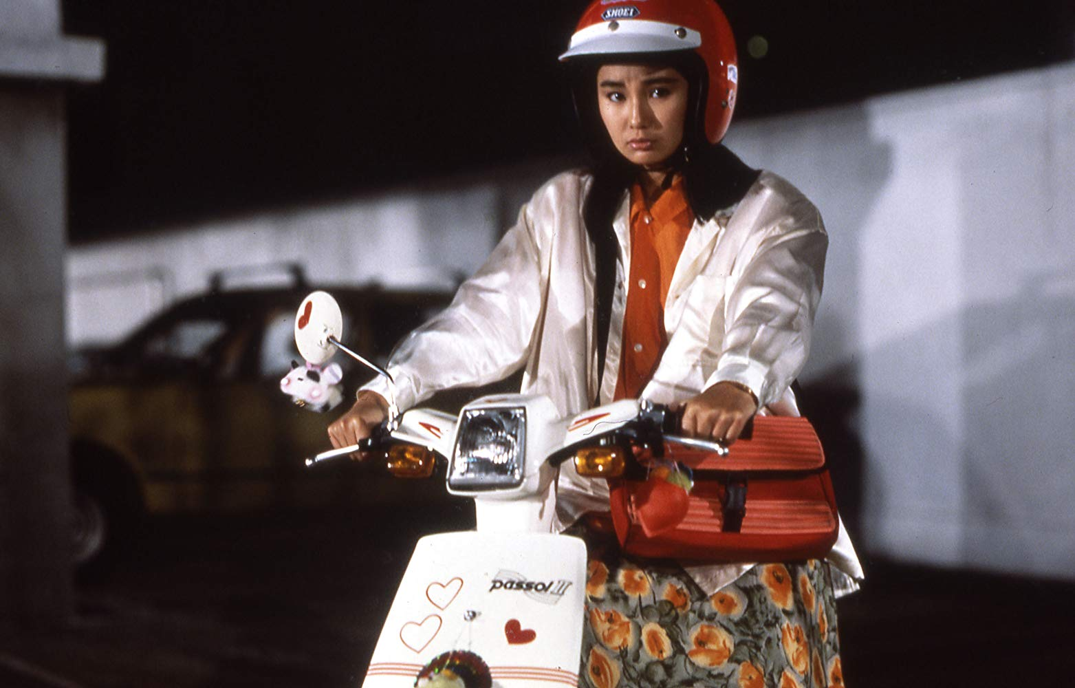 Maggie Cheung as May, Inspector Chan's girlfriend.