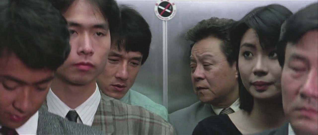 Chan talks with his fellow Inspector Uncle Bill Wong (Bill Tung).