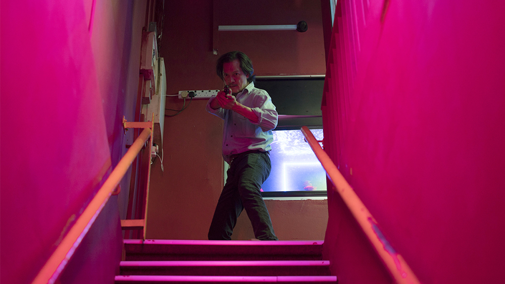 Detective Lok (Peter Yu)in Yeo Siew Hua's  A Land Imagined .