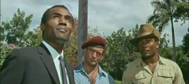 Curry (Rod Taylor) and Ruffo (Jim Brown) accept the mission from Ubi (Calvin Lockhart).