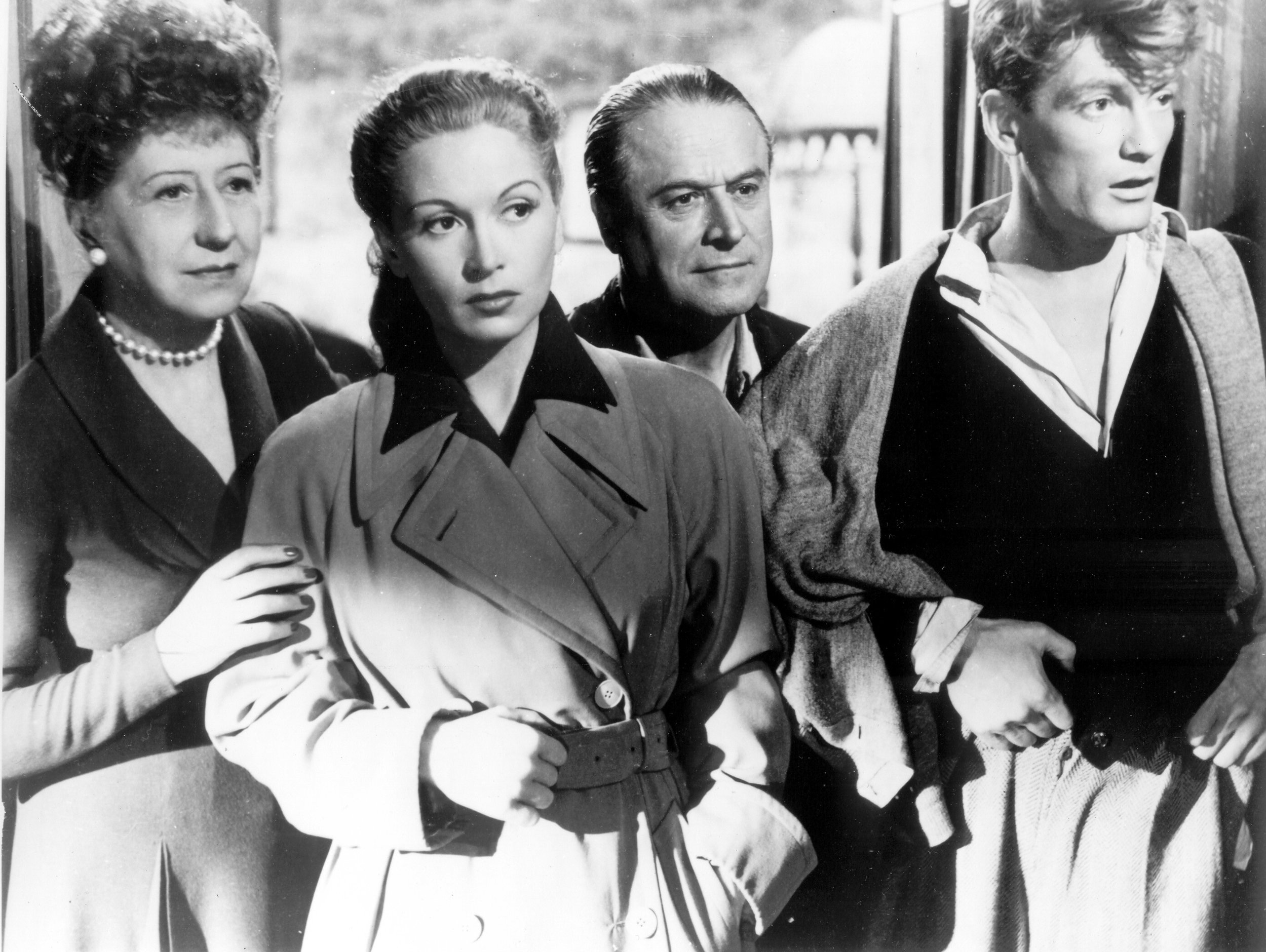 Gabrielle Dorziat as Aunt Leo, Josette Day as Madeleine, Marcel André as Georges, and Jean Marais as Michel. Photo courtesy of Photofest.