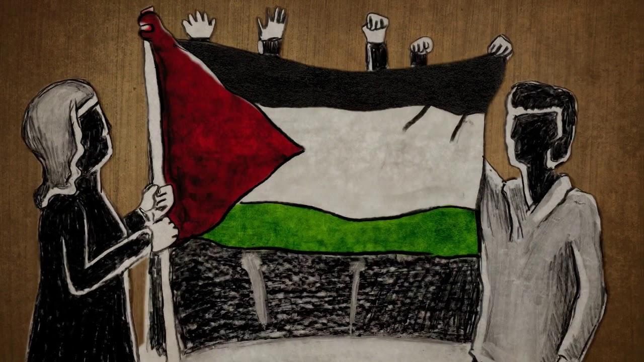 Women raise the hand-sewn Palestinian flag.
