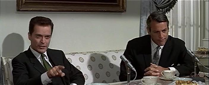 Dr. Carlo Farelli (Sergio Fantoni) and Dr. John Garrett (Kevin McCarthy) co-Laureates for medicine.