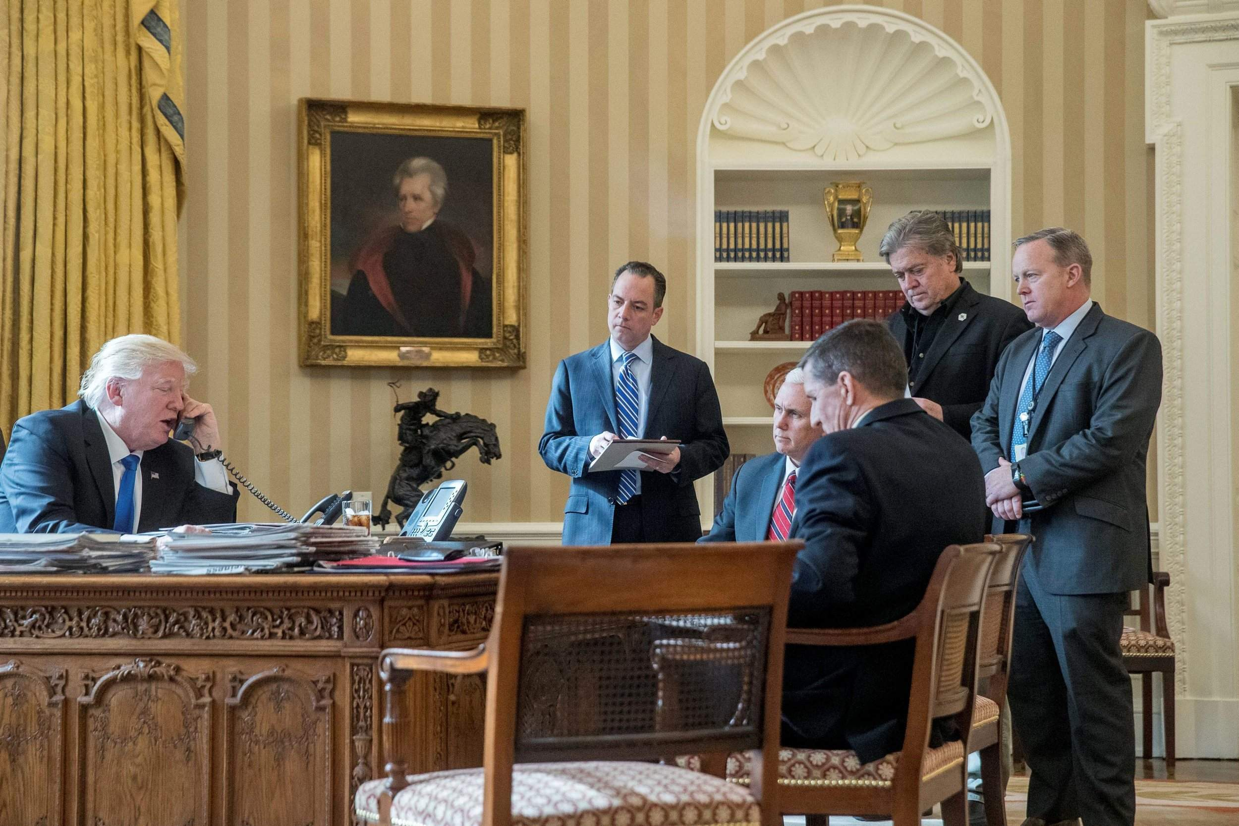 Trump and his advisers in the Oval Office.