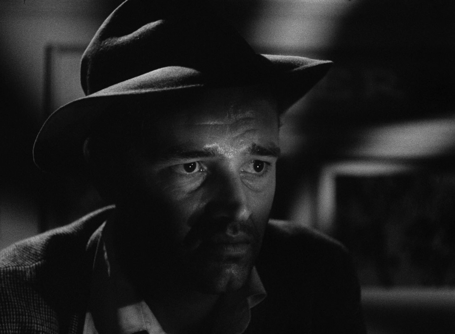The expressionist opening scene of  Detour  (1945), featuring down-and-out piano player Al Roberts (Tom Neal), quickly establishes the grim tone of Edgar G. Ulmer's classic film noir.