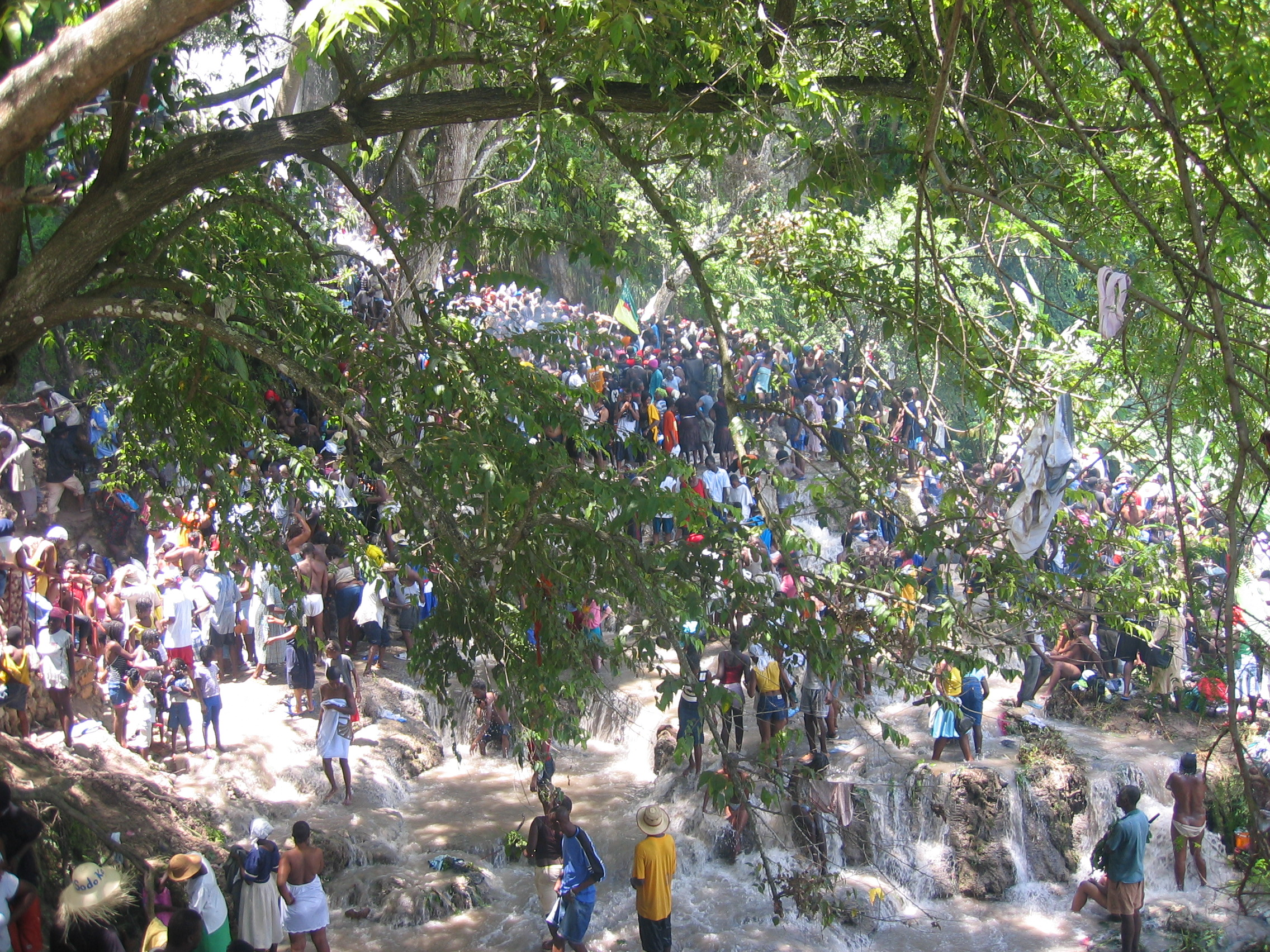 The masses of people in the sacred falls.