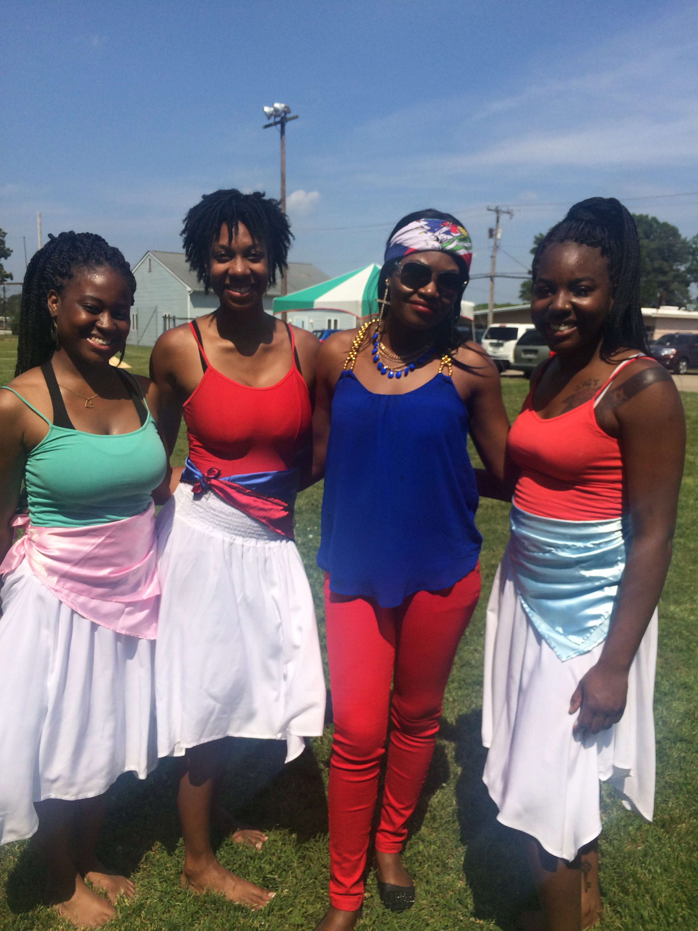 Kayla, Camille, and Shu'Keia with Wisline, a new friend interested in dancing together