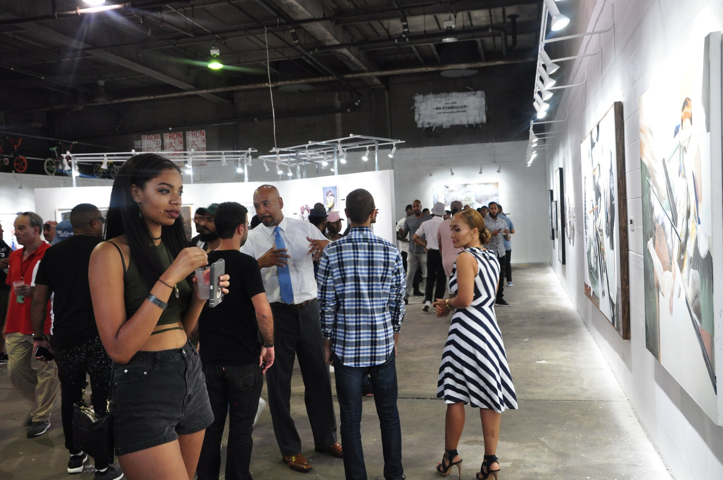 By Samali Bikangaga. Borough President Ruben Diaz Jr. (center, with blue tie) chats with fellow guests at No Commission NY.