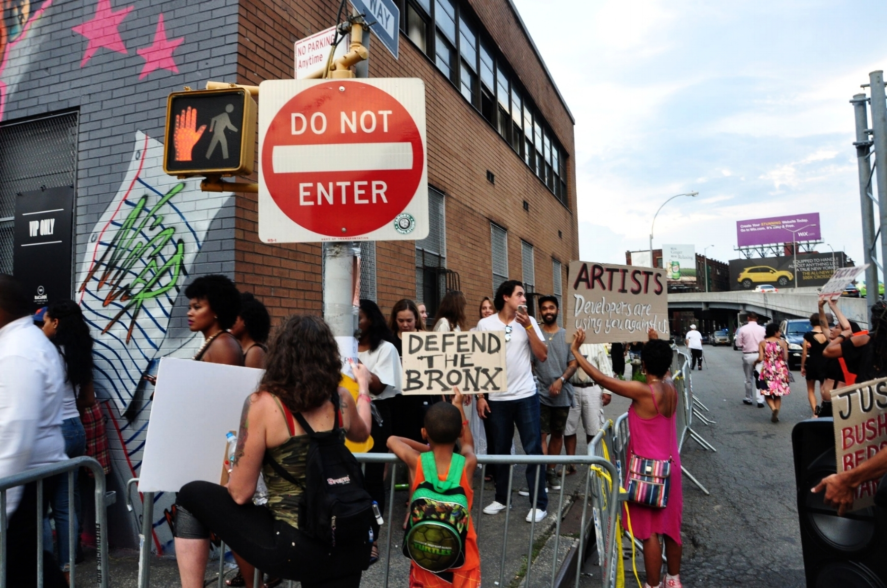 By Samali Bikangaga. Protesters rally outside 101 Lincoln Ave. to denounce the show