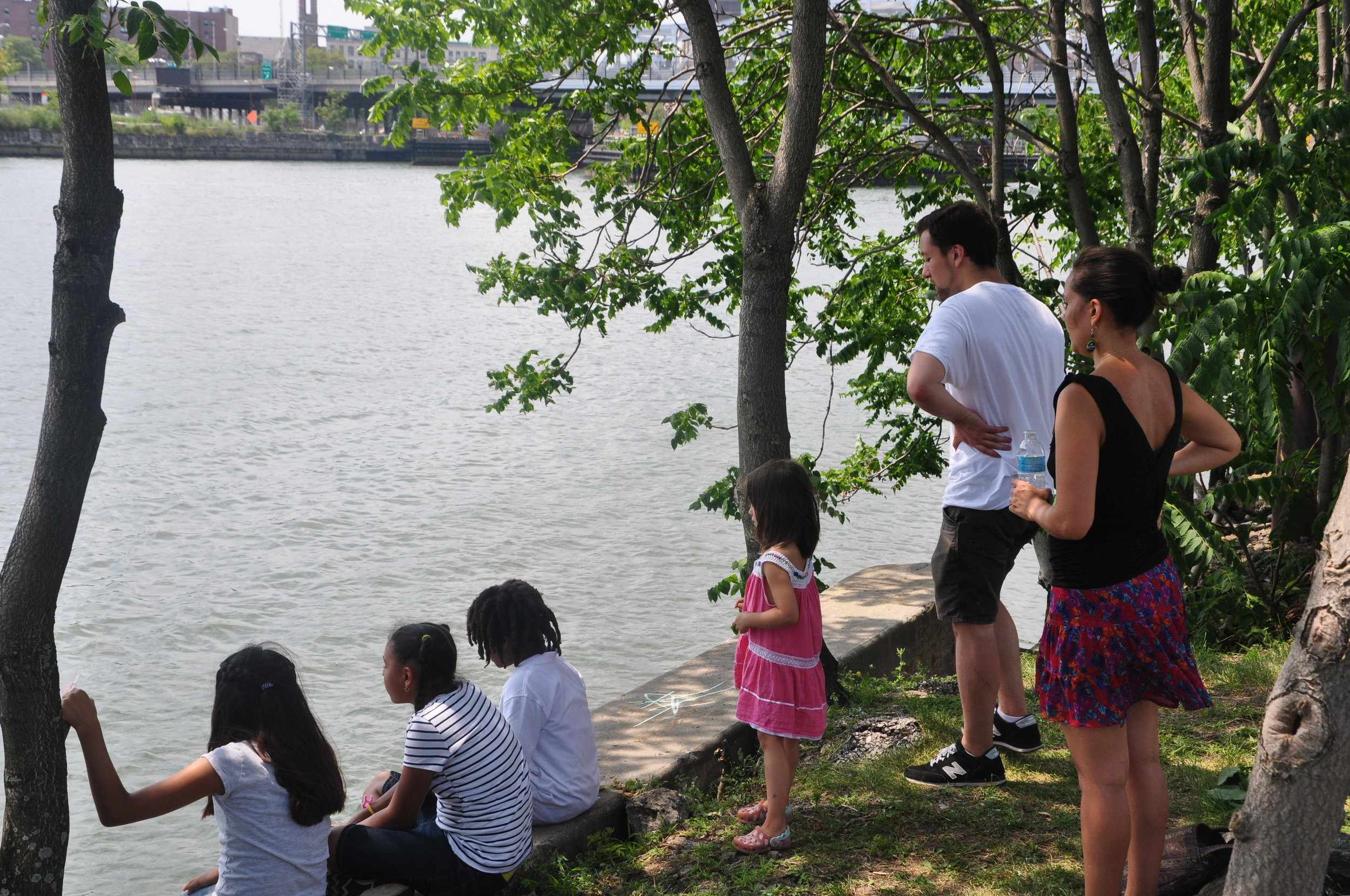 By Samali Bikangaga. Residents celebrate City of Water Day on the banks of the Harlem River in Port Morris waterfront on July 16.
